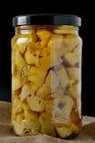 Preserve of artichokes in olive oil Stock Photos