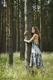 Preserve Mother Nature. A Young Woman Embracing a Forest Tree with Open Heart, Expressing her Love to Nature Stock Photo