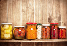 Preserved  autumn vegetables on shelf Stock Photo