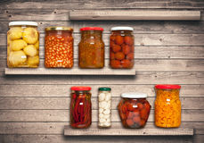 Preserved carrots, tomatoes, garlic, chilli, beans Royalty Free Stock Photography