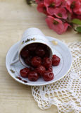 Preserved cherrys. Sweet preserved cherrys on a wooden board Royalty Free Stock Image