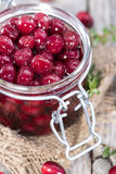 Preserved Cranberries. Homemade preserved Cranberries (with some fresh fruits Stock Photo