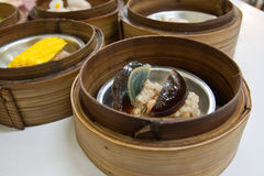 Preserved egg Dimsum in bamboo container closed up Royalty Free Stock Photography