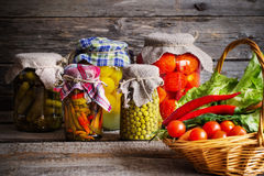 Preserved and fresh vegetables Royalty Free Stock Photo