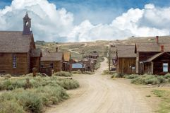 A view down the main street running through ghost town Bodie, in stock photography