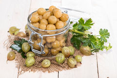 Preserved Gooseberries. Portion of preserved Gooseberries with some fresh fruits stock images