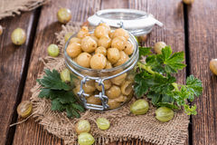 Preserved Gooseberries. Portion of preserved Gooseberries with some fresh fruits royalty free stock photos