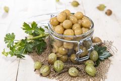 Preserved Gooseberries. Portion of preserved Gooseberries with some fresh fruits royalty free stock images