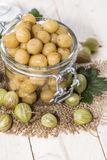 Preserved Gooseberries. Portion of preserved Gooseberries with some fresh fruits stock photos