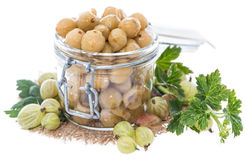 Preserved Gooseberries on white. Portion of preserved Gooseberries with some fresh fruits isolated on white Stock Images