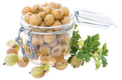 Preserved Gooseberries on white. Portion of preserved Gooseberries with some fresh fruits isolated on white Royalty Free Stock Images