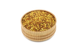 Preserved grain mustard in a wooden dish Royalty Free Stock Photography