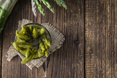 Preserved green Asparagus. (selective focus) on wooden background Royalty Free Stock Images
