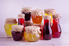 Preserved homemade fruits and berries jam in the jar. Rustic sty Royalty Free Stock Image