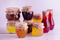 Preserved homemade fruits and berries jam in the jar. Rustic sty Royalty Free Stock Photography