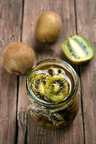 Preserved kiwi in jar Royalty Free Stock Photo
