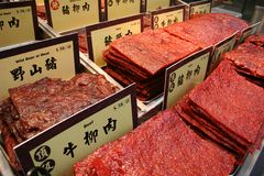 Preserved Meat. Assortment of Chinese preserved meat selling by the sidewalk of Macau, China. (No trademark or copyrighted material on the price tags Royalty Free Stock Image