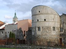 Preserved mediaeval walls and bastion with a church tower in the background. Preserved mediaeval walls and bastion in the urban conservation area with a church Royalty Free Stock Image