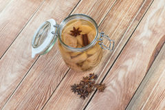 Preserved Pear Compote with Star Anise and Cinnamon in Glass Jar Royalty Free Stock Photography