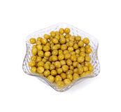 Preserved peas in crystal bowl on a white Royalty Free Stock Photos
