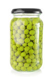 Preserved peas. Preserved green peas in a glass jar Stock Image