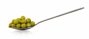 Preserved peas in spoon isolated. On white background Stock Image