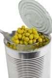 Preserved peas vegetable in metal spoon closeup Royalty Free Stock Photography