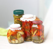 Preserved pickled tomatoes cucumbers in jar, canned vegetables Royalty Free Stock Images