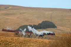 Cumbrian Mountain Express on Dandry Mire Viaduct. Preserved steam train 45699 Galatea with the Cumbrian Mountain Express on the famous Settle to Carlisle railway Royalty Free Stock Images