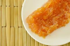 Preserved stir pineapple Thai sweet food on plate Stock Image