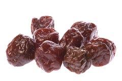 Preserved Sweetened Plums. Isolated macro image of preserved sweetened plums Royalty Free Stock Photography