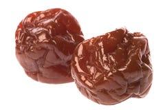 Preserved Sweetened Plums. Isolated macro image of preserved sweetened plums Royalty Free Stock Photo