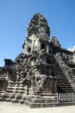 Preserved 12th century Angkor Wat temple with steep staircasePreserved 12th century Angkor Wat temple with steep staircase. Scene around the Angkor Royalty Free Stock Photography