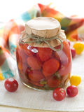 Preserved  tomato. In glass jar, selective focus Royalty Free Stock Photography
