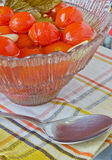Preserved tomatoes. In a bowl on the table Stock Photography
