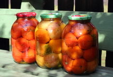 Preserved tomatoes in the glass cans Royalty Free Stock Image