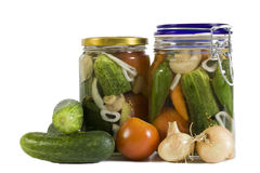 Preserved vegetables. Vegetables for preservation - union, tomato and cucumber Royalty Free Stock Images