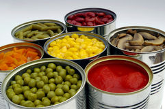 Preserved vegetables mix. Cans of different preserved vegetables Stock Images