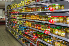 Preserved vegetables the shelf in supermarket Stock Image