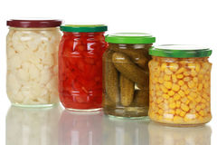 Preserved vegetables in glass jars Stock Photography