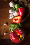 Preserved wegetables in jars. Preserved cucumbers, peppers and patisson in jars Stock Photography