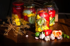 Preserved wegetables in jars. Preserved cucumbers, peppers and patisson in jars Stock Image