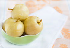 Preserved whole apples in bowl Royalty Free Stock Image