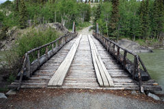A preserved wooden bridge in the yukon territories. Royalty Free Stock Photo
