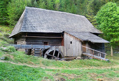 Preserved wooden water-sawmill in Oblazy. View of unique and preserved old-time wooden water-sawmill hidden in forests of Oblazy during summer day. This Stock Photo