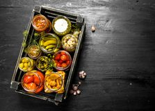 Preserves Vegetables In Glass Jars In An Old Box. Stock Images
