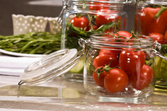Preserving. Food series: preserving of fresh tomato and marrow Royalty Free Stock Photography