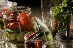 Preserving. Food series: preserving of tomato, marrow and pepper Stock Images