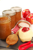 Preserving freshly made applesauce Royalty Free Stock Images