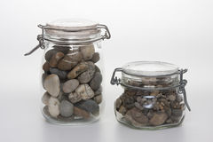 Preserving Jars filled with Pebbles Royalty Free Stock Images